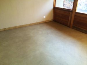 room with seamless cement floor